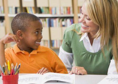 photodune-313922-kindergarten-teacher-helping-student-with-reading-skills-s-600x450