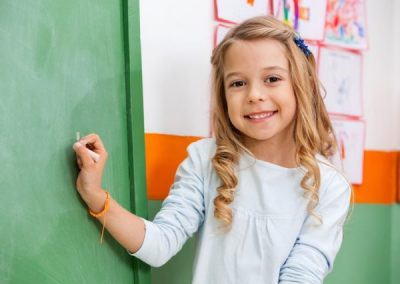 photodune-5046927-cute-girl-writing-on-board-in-kindergarten-s-600x450
